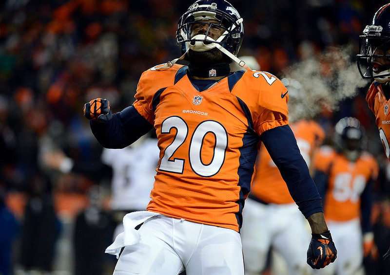 . Denver Broncos strong safety Mike Adams (20) gets amped up during the fourth quarter.  The Denver Broncos vs Baltimore Ravens AFC Divisional playoff game at Sports Authority Field Saturday January 12, 2013. (Photo by Tim Rasmussen,/The Denver Post)