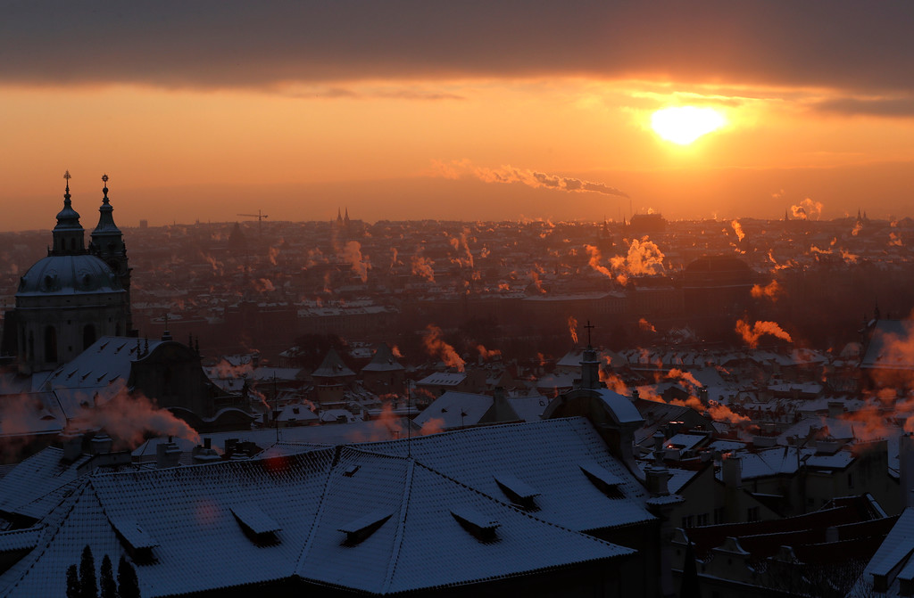 . Smoke rises from chimneys during a freezing winter morning in Prague, Czech Republic, Wednesday, Jan. 11, 2017. Central Europe has been hit by unusually freezing weather in recent days. (AP Photo/Petr David Josek)