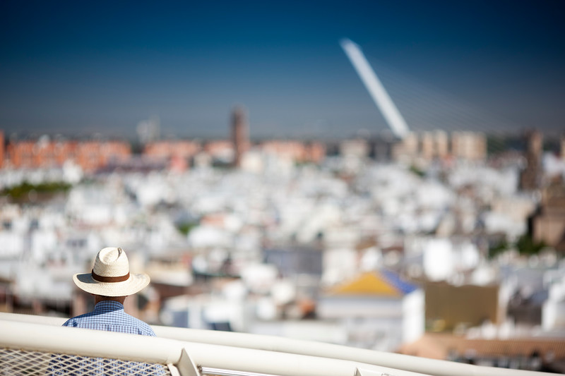 Visitor looking at the city of Seville (Spain) from the top of Metropol Parasol building