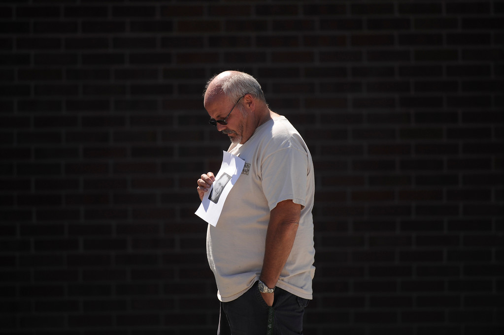 . Tom Sullivan holds up a photo of his son Alex Sullivan outside Gateway High School, Friday July 20, 2012, in Aurora. Tom Sullivan was still missing his son, who would later be confirmed dead inside the Aurora movie theater. RJ Sangosti, The Denver Post
