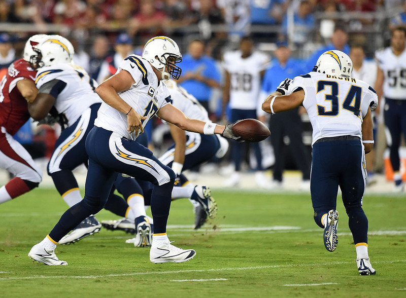 . Quarterback Philip Rivers #17 of the San Diego Chargers hands off the ball to running back Donald Brown #34 against the Arizona Cardinals in the first quarter at University of Phoenix Stadium on September 8, 2014 in Glendale, Arizona.  (Photo by Norm Hall/Getty Images)