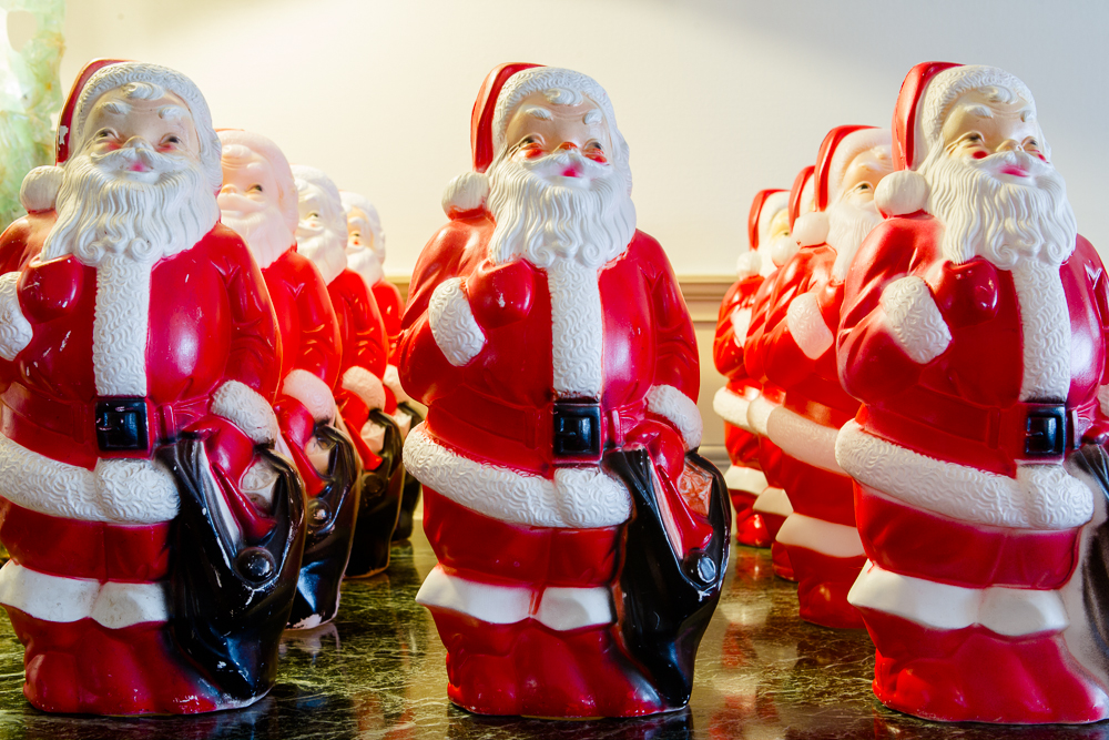. Phil Bender\'s brigade of Santas are part of a work that graces the Governor\'s Residence at Boettcher Mansion during the holidays. Photo by Mark Broste