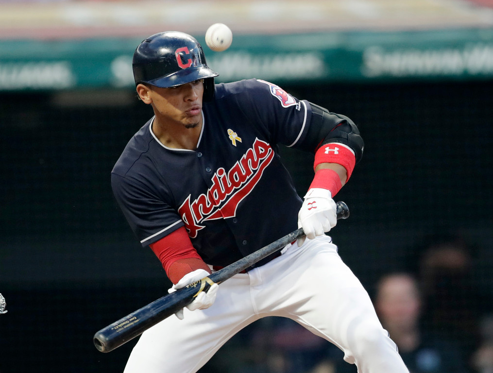 . Cleveland Indians\' Erik Gonzalez bunts against Tampa Bay Rays starting pitcher Blake Snell in the second inning of a baseball game, Saturday, Sept. 1, 2018, in Cleveland. Gonzalez was out on the play. (AP Photo/Tony Dejak)