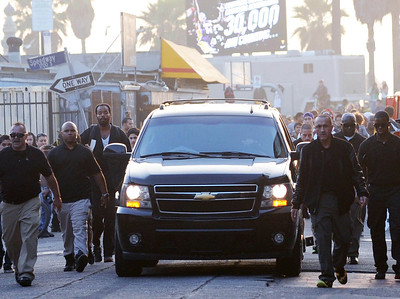 EXC: Kobe Bryant Has Five Bodyguards Running Alongside His SUV