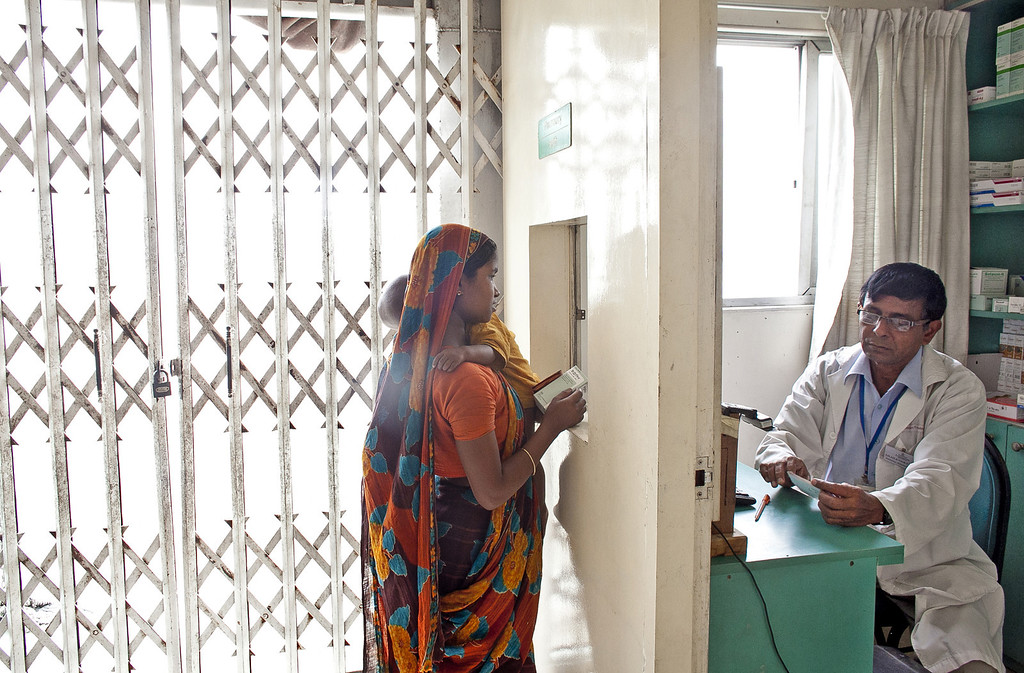 """. A women visits the pharmacy at the Emirates Friendship Floating Hospital May 19, 2014 in Chilmari district, Bangladesh. Friendship floating hospitals dock for up to 5 months at remote islands, or \""""chors\"""", in the north of Bangladesh with a full medical team and stocked pharmacy, providing health care at affordable cost. (Photo by Allison Joyce/Getty Images)"""