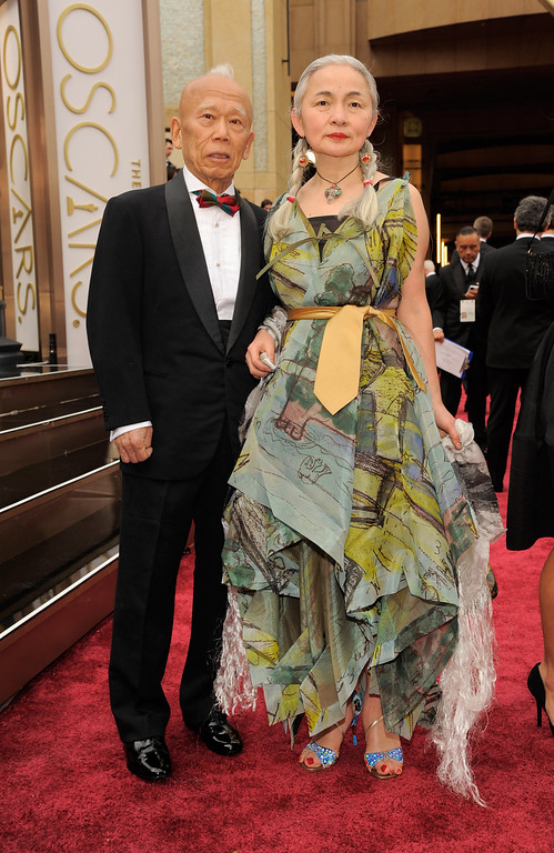 . Ushio Shinohara, and Noriko Shinohara arrive at the Oscars on Sunday, March 2, 2014, at the Dolby Theatre in Los Angeles.  (Photo by Chris Pizzello/Invision/AP)