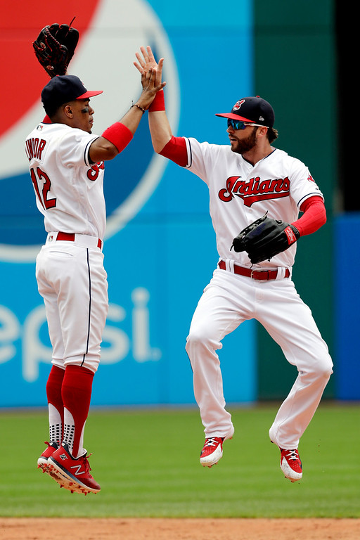 . Cleveland Indians\' Francisco Lindor, left, celebrates with Tyler Naquin after the Indians defeated the Chicago White Sox 12-0 in a baseball game, Wednesday, June 20, 2018, in Cleveland. (AP Photo/Tony Dejak)
