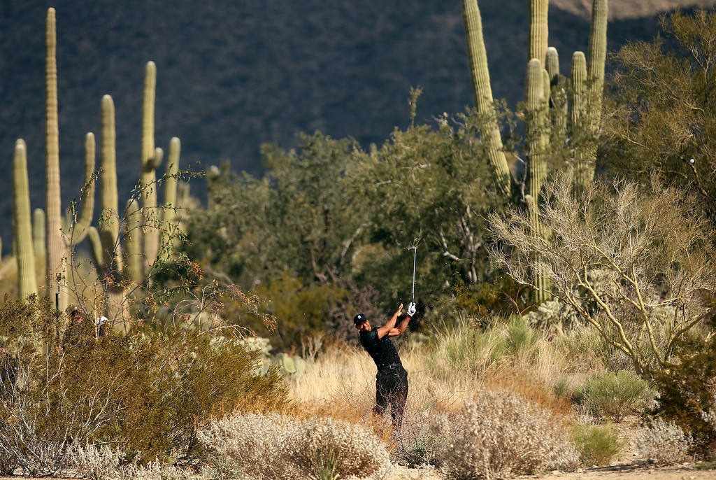 . MARANA, AZ - FEBRUARY 21:  Tiger Woods hits his second shot on the second hole during the first round of the World Golf Championships - Accenture Match Play at the Golf Club at Dove Mountain on February 21, 2013 in Marana, Arizona. Round one play was suspended on February 20 due to inclimate weather and is scheduled to be continued today.  (Photo by Darren Carroll/Getty Images)