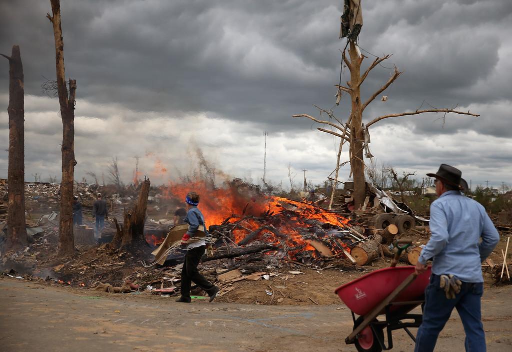 . Volunteers clean up and burn tornado debris, April 30, 2014 in Vilonia, Arkansas.  (Photo by Mark Wilson/Getty Images)