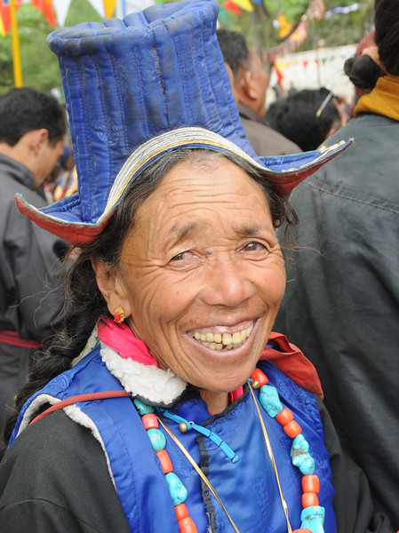 Woman listening to the Dalai Lama speak.