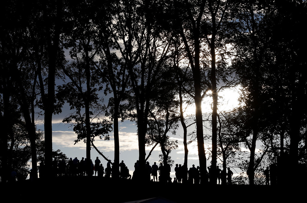 . Fans watch golfers on the 17th green during a four-ball match at the Presidents Cup golf tournament at Muirfield Village Golf Club on Thursday, Oct. 3, 2013, in Dublin, Ohio. (AP Photo/Darron Cummings)