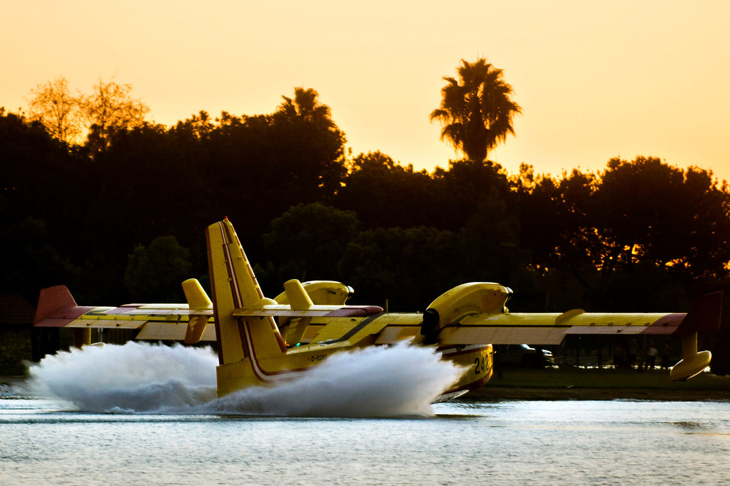 . A Super Scooper air tanker makes a stop to refill at Santa Fe Dam Recreational Area in Irwindale while battling the Madre Fire in the Angeles National Forest above Azusa, Calif. that has burned about 50 acres on Monday evening, Sept. 23, 2013. (Photo by Watchara Phomicinda/ San Gabriel Valley Tribune)