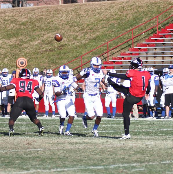 Trever Austin (1) punts the ball.