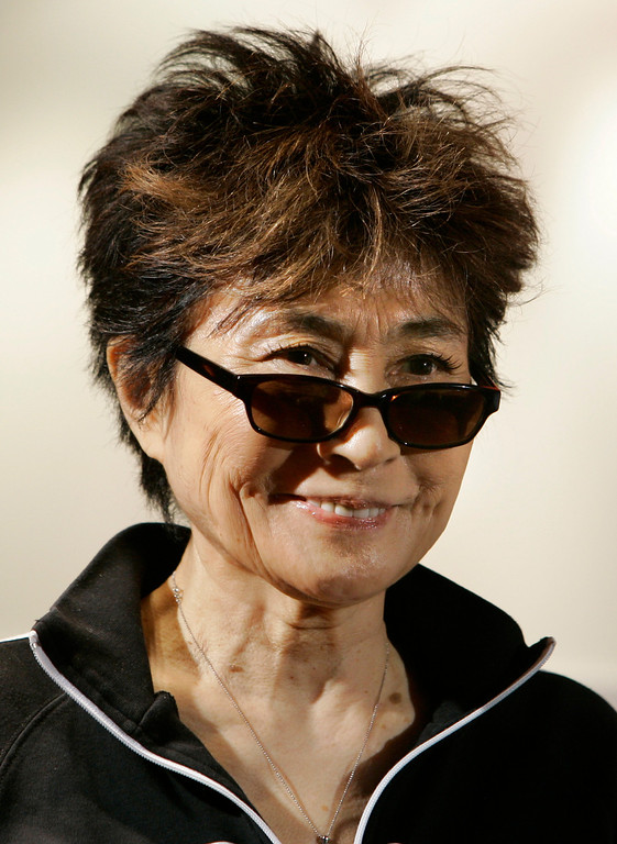 """. Yoko Ono, during a visit to Amnesty International\'s London headquarters, in this Sept. 24, 2007, file photo.  Ono, the world\'s most famous unknown artist, as her late husband John Lennon called her, will open an exhibition with about 80 of her artwork in South America\'s largest city this weekend.   The exhibition, called \""""Yoko Ono, a Retrospective,\"""" begins Saturday, Nov. 10, 2007, and will stay in Sao Paulo until Feb. 3. (AP Photo/Kirsty Wigglesworth)"""