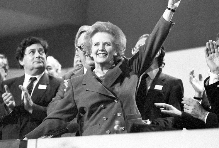. Then British Prime Minister Margaret Thatcher points skyward as she receives standing ovation at Conservative Party Conference in this October 13, 1989 file photo. Thatcher has died following a stroke, a spokesman for the family said. REUTERS/Stringer/Files