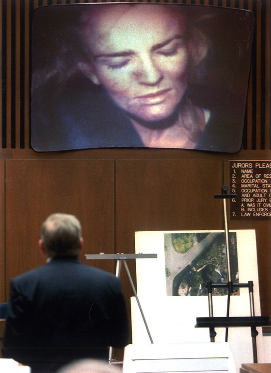 . The prosecution projects a police photograph of Nicole Brown Simpson showing her injuries after a 1989 beating as evidence against her ex-husband, O.J. Simpson.   (1995)  (Los Angeles Daily News file photo)