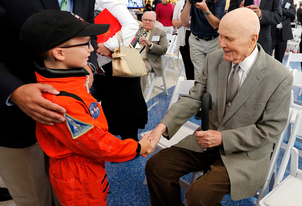 . FILE � In this June 28, 2016, file photo, former astronaut and U.S. Sen. John Glenn, D-Ohio, right, shakes hands with 8-year-old Josh Schick, left, before an event to mark the September 2016 renaming of Port Columbus International Airport to John Glenn Columbus International Airport in Columbus, Ohio. Glenn, the first American to orbit the Earth, turned 95 on Monday, July 18, 2016, and was trending on Twitter as well-wishers recognized his birthday. (AP Photo/Jay LaPrete, File)