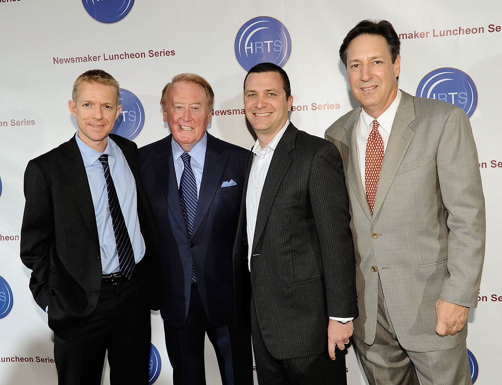 . (L-R) Kevin Beggs, HRTS President, Voice of the Los Angeles Dodgers Vin Scully, producer Jordan Levin and Andy Friendly attend the Hollywood Radio & Television Society Newsmaker Lunheon at the Beverly Wilshire Hotel  on November 10, 2009 in Beverly Hills, California.  (Photo by Michael Buckner/Getty Images)