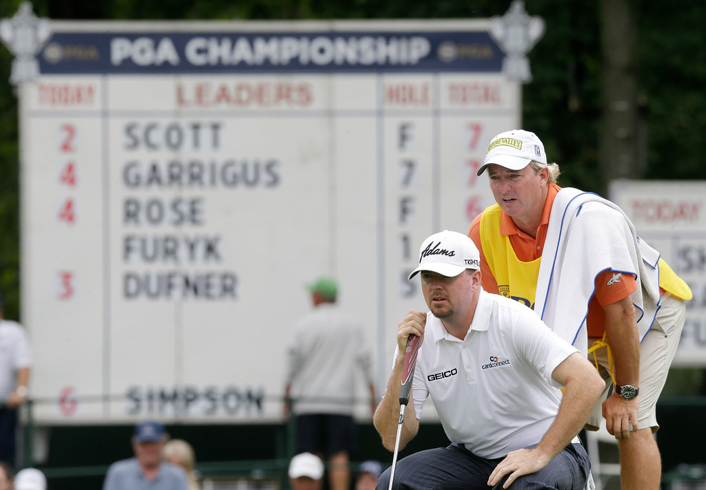 . Robert Garrigus, left, and his caddie Brent Henley line up a putt on the eighth hole during the second round of the PGA Championship golf tournament at Oak Hill Country Club, Friday, Aug. 9, 2013, in Pittsford, N.Y. (AP Photo/Patrick Semansky)