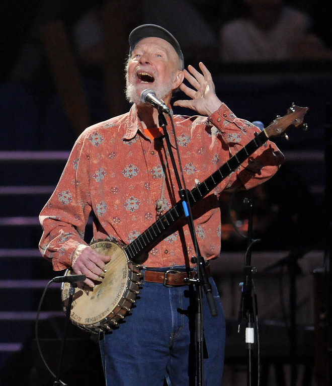 . Pete Seeger performs at the benefit concert celebrating his 90th birthday at Madison Square Garden on Sunday, May 3, 2009 in New York. The concert is a benefit for Hudson River Sloop Clearwater, a sloop created by Pete Seeger to preserve and protect the Hudson River. (AP Photo/Evan Agostini)