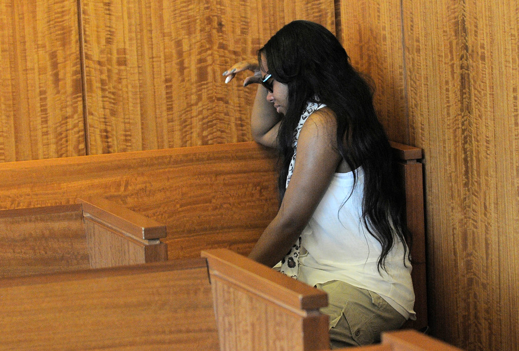 . Shayanna Jenkins, fiancee of former New England Patriots football player Aaron Hernandez, weeps in the courtroom after a bail hearing for Hernandez in Fall River Superior Court Thursday, June 27, 2013, in Fall River, Mass. Hernandez, charged with murdering Odin Lloyd, a 27-year-old semi-pro football player, was denied bail. (AP Photo/Boston Herald, Ted Fitzgerald, Pool)