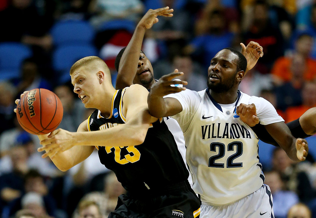 . BUFFALO, NY - MARCH 20:  J.J. Panoske #23 of the Milwaukee Panthers and JayVaughn Pinkston #22 of the Villanova Wildcats go for a lose ball during the second round of the 2014 NCAA Men\'s Basketball Tournament at the First Niagara Center on March 20, 2014 in Buffalo, New York.  (Photo by Elsa/Getty Images)