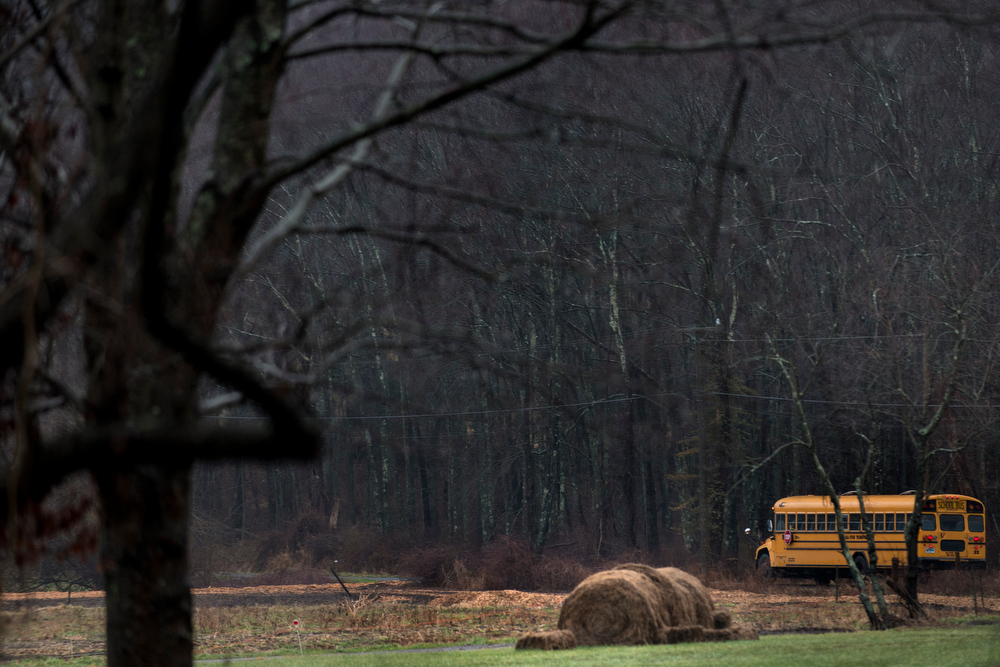 Description of . A school bus drives past a field while picking up students December 18, 2012 in Newtown, Connecticut. Students in Newtown, excluding Sandy Hook Elementary School, return to school for the first time since last Friday's shooting at Sandy Hook which took the live of 20 students and 6 adults.  BRENDAN SMIALOWSKI/AFP/Getty Images