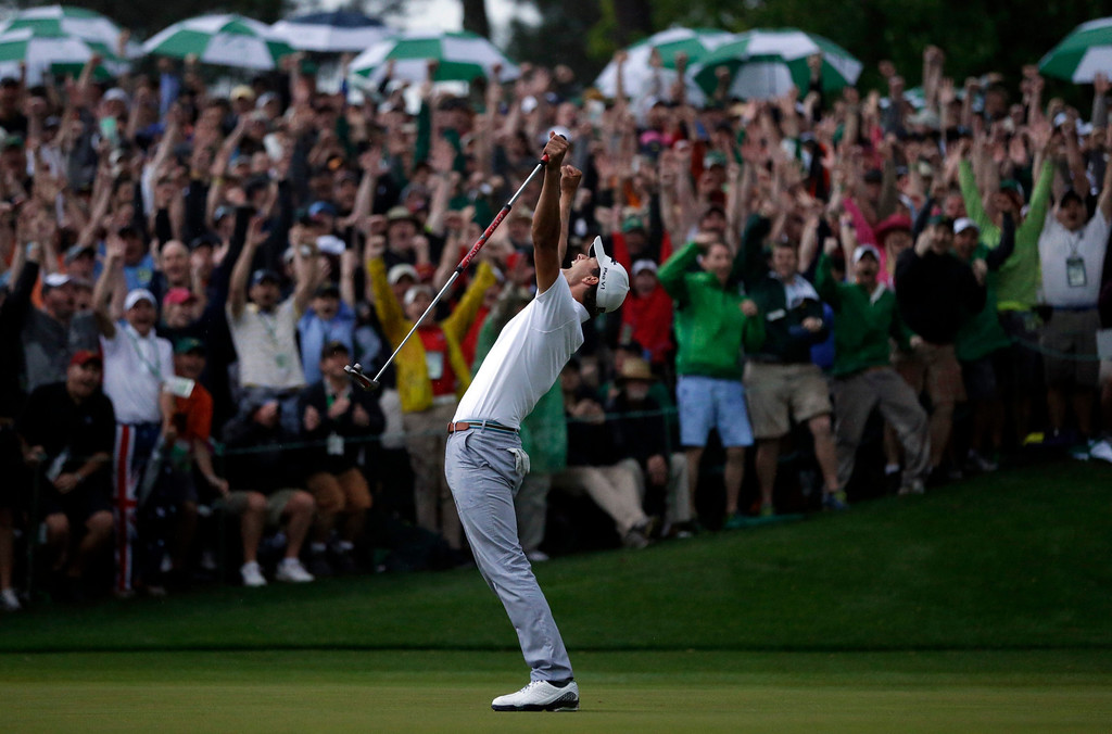 . Adam Scott, of Australia, celebrates after making a birdie putt on the second playoff hole to win the Masters golf tournament Sunday, April 14, 2013, in Augusta, Ga. (AP Photo/David J. Phillip, File)