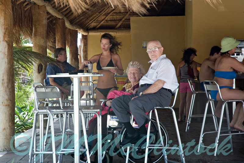 My parents in the beach front cabana watching the activities on the beach.  Grand Sirenis Resort.  Riviera Maya.
