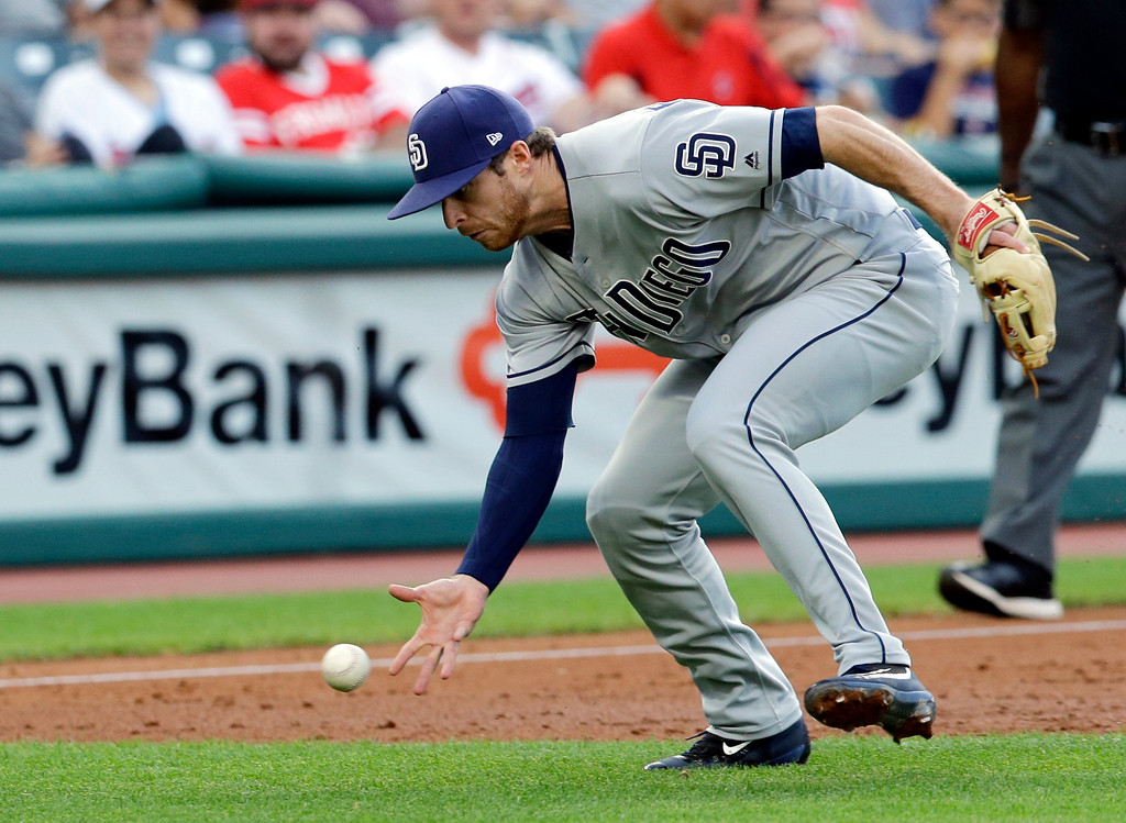 . San Diego Padres\' Cory Spangenberg barehands the ball before throwing to first base to get Cleveland Indians\' Erik Gonzalez in the third inning of a baseball game, Wednesday, July 5, 2017, in Cleveland. Gonzalez advanced to second base due to a throwing error by Spangenberg. (AP Photo/Tony Dejak)