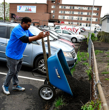 5/4/2019 Mike Orazzi | Staff Comcast's Andre Christian while cleaning up the New Britain Berlin YMCA as part of the 18th annual Comcast Cares Day on High Street in New Britain Saturday.