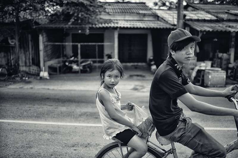 This boy and girl were passing by on a bike.  We were all equally curious of each other.