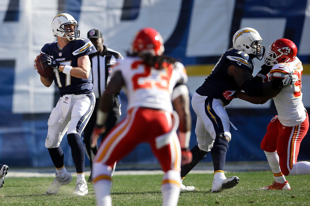 . San Diego Chargers quarterback Philip Rivers, left, looks to throw a pass against the Kansas City Chiefs during the first half in an NFL football game, Sunday, Dec. 29, 2013, in San Diego. (AP Photo/Lenny Ignelzi)