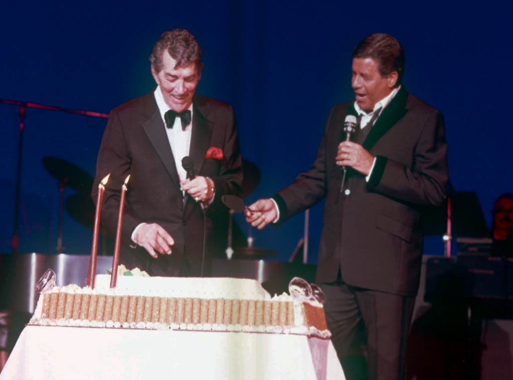 . FILE - Dean Martin, left, laughs after former partner Jerry Lewis, right, presented the famed entertainer with a giant cake in honor of his 72nd birthday at Bally\'s in Las Vegas June 8, 1989.   (AP Photo, files)