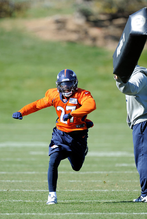 . Denver Broncos running back Knowshon Moreno (27) runs through drills during practice October 24, 2013 at Dove Valley. (Photo by John Leyba/The Denver Post)