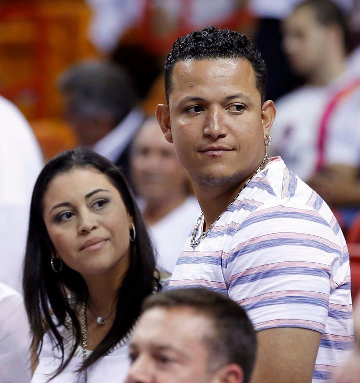 . Major League baseball player Miguel Cabrera (R) of Venezuela and his wife Rosangel Cabrera arrive to watch the Miami Heat play the Indiana Pacers in Game 7 of their NBA Eastern Conference final basketball playoff in Miami, Florida June 3, 2013. REUTERS/Joe Skipper