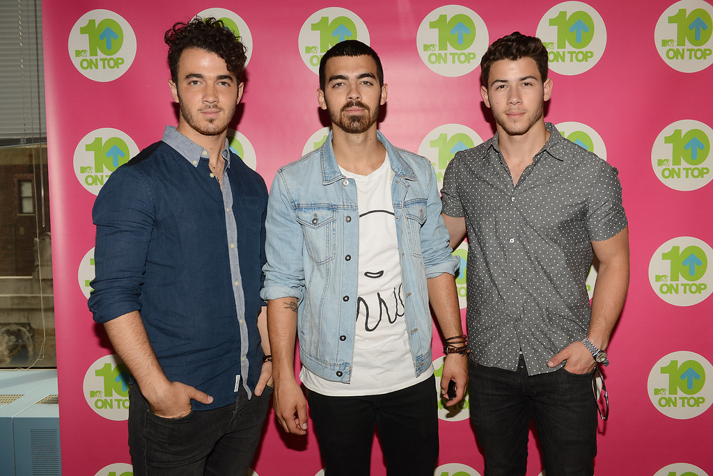 """. August 16, 2013: Jonas Brothers<br /> <br />(Left to right) Kevin Jonas, Joe Jonas, and Nick Jonas pose for a photo during a taping of MTV\'s \""""10 On Top\"""" at the MTV Studios on Wednesday, July 24, 2013 in New York City. (Photo by Scott Gries/Invision/AP)"""