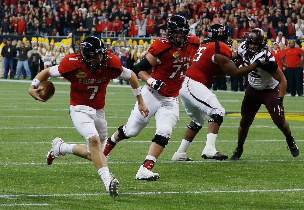 Description of . Seth Doege #7 of Texas Tech rushes for a 4 yards touchdown against Minnesota during the Meineke Car Care of Texas Bowl at Reliant Stadium on December 28, 2012 in Houston, Texas.  (Photo by Scott Halleran/Getty Images)