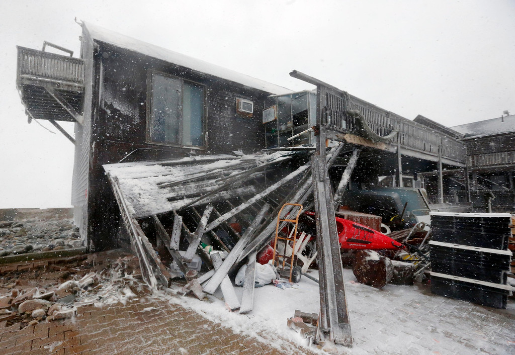 . A house damaged by ocean waves during a winter storm is seen in Marshfield, Mass., Tuesday, Jan. 27, 2015. The storm punched out a section of the seawall in the coastal town of Marshfield, police said.(AP Photo/Michael Dwyer)