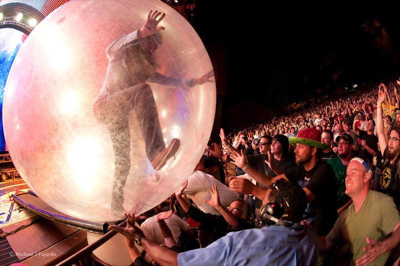"Wayne Coyne making his way into the crowd in his space bubble. The Flaming Lips Performing Pink Floyd's ""The Dark Side of the Moon"" Red Rocks Amphitheater Morrison, CO August 4, 2011"