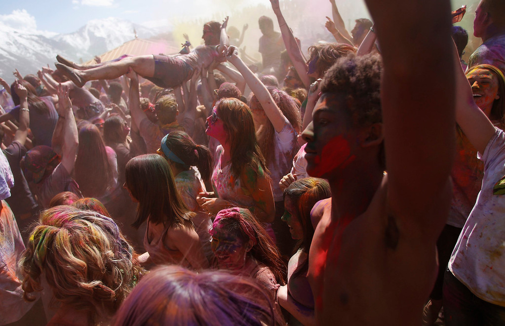 . Participants crowd surf, dance and throw colored chalk during the Holi Festival of Colors at the Sri Sri Radha Krishna Temple in Spanish Fork, Utah, March 30, 2013. REUTERS/Jim Urquhart
