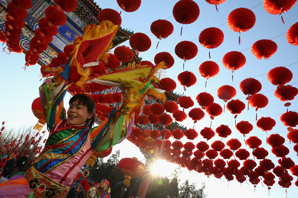 . Chinese folk artists perform during the opening ceremony of the Spring Festival Temple Fair at the Temple of Earth park on January 30, 2014 in Beijing, China.   (Photo by Feng Li/Getty Images)