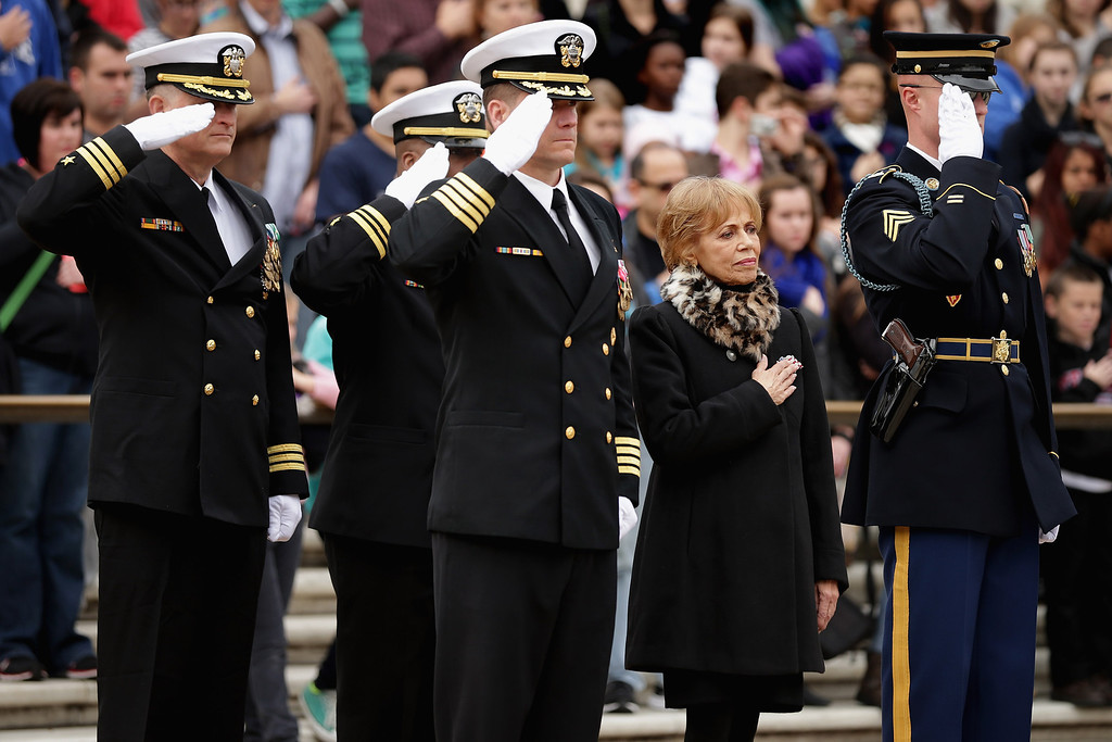 . Accompanied by members of the U.S. Navy SEALs, Carmella LaSpada (2nd R), White House Special Projects Aide to President John F. Kennedy, participates in a wreath laying ceremony at the Tomb of the Unknowns in honor of Kennedy at Arlington National Cemetery November 22, 2013 in Arlington, Virginia. Remembrance ceremonies were held across the United States today, the 50th anniversary of the assassination of President Kennedy. President Kennedy established the Navy SEALs in 1962 as a small, elite maritime military force to conduct unconventional warfare.  (Photo by Chip Somodevilla/Getty Images)