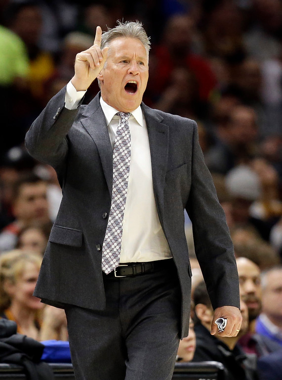 . Philadelphia 76ers coach Brett Brown yells instructions to players during the first half of the team\'s NBA basketball game against the Cleveland Cavaliers, Saturday, Dec. 9, 2017, in Cleveland. The Cavaliers won 105-98. (AP Photo/Tony Dejak)