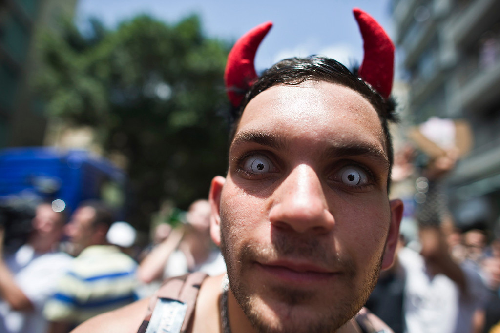 . A man looks on at a street in Tel Aviv during an annual Gay Pride parade in town June 7, 2013. Thousands of revelers on Friday paraded on the streets of Israel\'s free-wheeling city of Tel Aviv, which has become a Mediterranean hotspot for gay tourism. REUTERS/Nir Elias