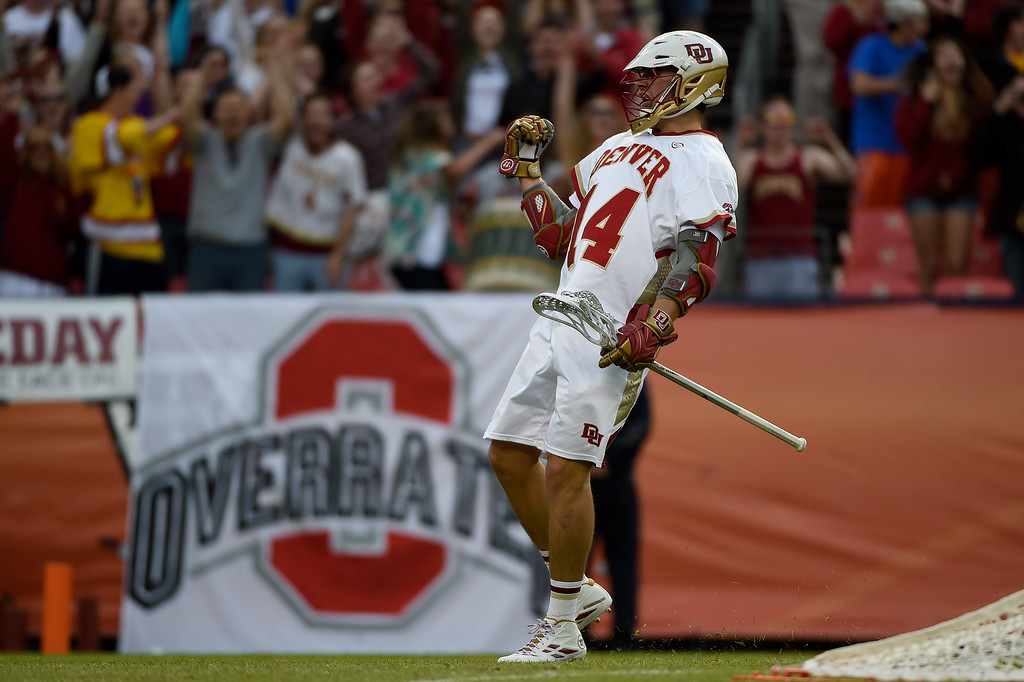 . Wesley Berg (14) of the Denver Pioneers cuts the Ohio State Buckeyes lead to 7-6 during the first half of their NCAA tournament quarterfinal match. The Denver Pioneers played the Ohio State Buckeyes at Sports Authority field at Mile High on Saturday, May 16, 2015. (Photo by AAron Ontiveroz/The Denver Post)