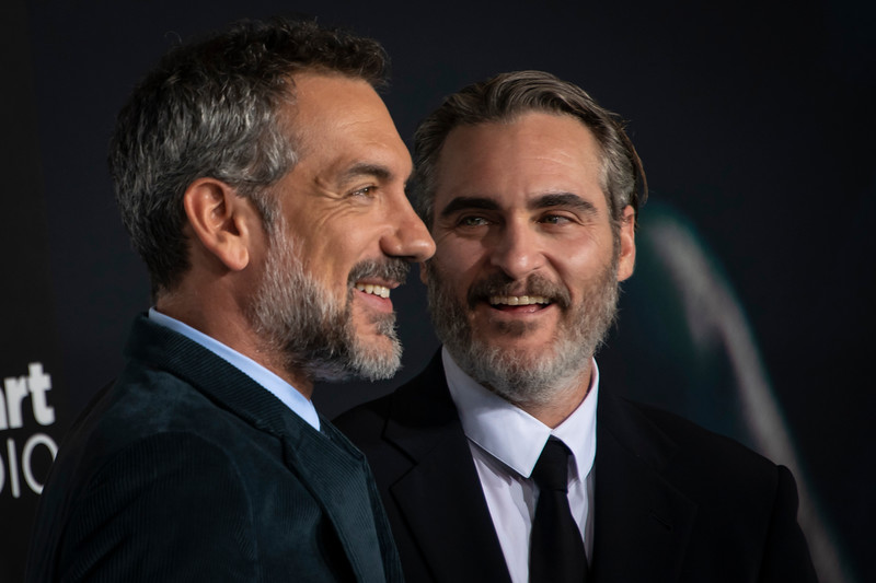 """HOLLYWOOD, CALIFORNIA - SEPTEMBER 28: Todd Phillips and Joaquin Phoenix attend the premiere of Warner Bros Pictures """"Joker"""" on Saturday, September 28, 2019 in Hollywood, California. (Photo by Tom Sorensen/Moovieboy Pictures)"""