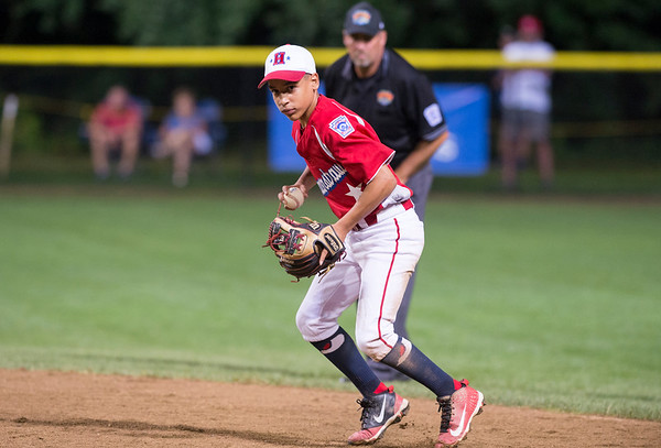 08/08/19 Wesley Bunnell | Staff New York defeated Washington, DC 15-4 on Thursday August 8, 2019 in a Mid Atlantic Region tournament game. New York second baseman Gabriel Reyes throws to first for the out.