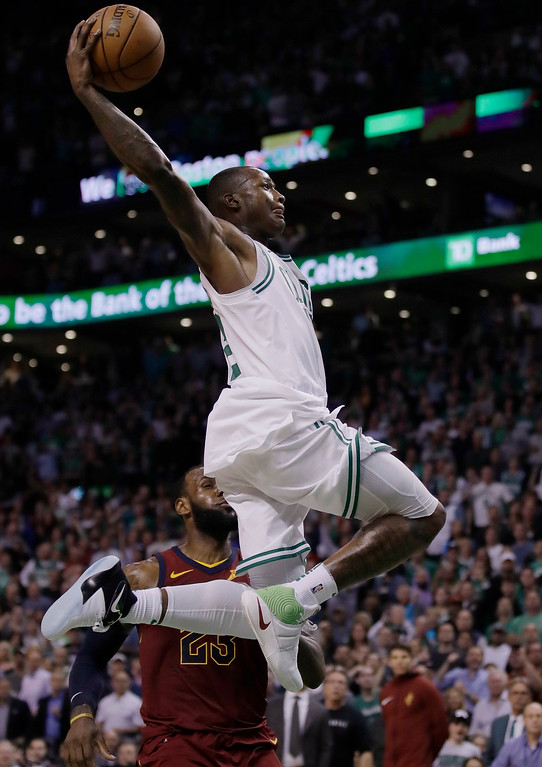 . Boston Celtics guard Terry Rozier soars toward the basket past Cleveland Cavaliers forward LeBron James during the second half in Game 2 of the NBA basketball Eastern Conference finals, Tuesday, May 15, 2018, in Boston. (AP Photo/Charles Krupa)