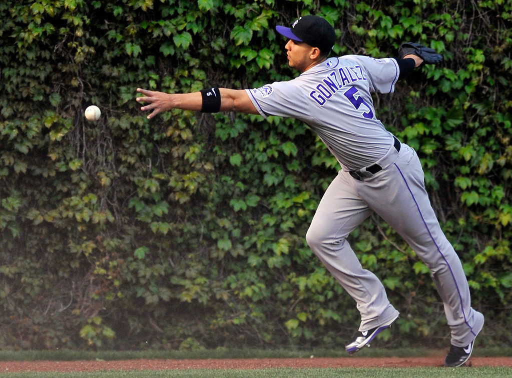 . Colorado Rockies left fielder Carlos Gonzalez misses a double hit by Chicago Cubs\' Anthony Rizzo during the first inning of a baseball game in Chicago, Wednesday, May 15, 2013. (AP Photo/Paul Beaty)